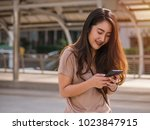 young asian woman using... | Shutterstock . vector #1023847915