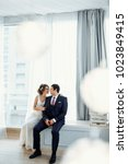 groom and bride posing and... | Shutterstock . vector #1023849415
