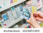 hand holding medicine capsule...   Shutterstock . vector #1023851305