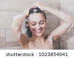 young beautyful woman under... | Shutterstock . vector #1023854041