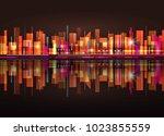 night city skyline with neon... | Shutterstock . vector #1023855559