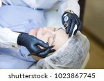 unknown beautician in gloves...   Shutterstock . vector #1023867745
