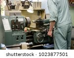 people working at a town factory | Shutterstock . vector #1023877501