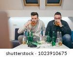 friends watching sport on tv at ... | Shutterstock . vector #1023910675