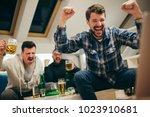 group of friends watching sport ... | Shutterstock . vector #1023910681