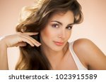 natural young woman with long... | Shutterstock . vector #1023915589