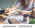 young women traveler planning... | Shutterstock . vector #1023916411