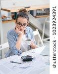 young women doing paper work at ... | Shutterstock . vector #1023924391