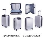 set of big grey travel luggage... | Shutterstock . vector #1023939235