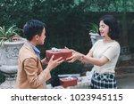 girlfriend preparing to gift... | Shutterstock . vector #1023945115
