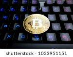bitcoin on keyboard | Shutterstock . vector #1023951151