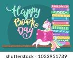 happy book day. unicorn reading ... | Shutterstock .eps vector #1023951739