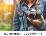 traveler woman with vintage... | Shutterstock . vector #1023954445