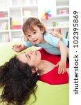 Mother playing with beautiful toddler child - stock photo