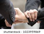 hand join for teamwork unity... | Shutterstock . vector #1023959869