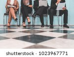 four applicants  sitting on... | Shutterstock . vector #1023967771