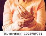 elderly woman applying... | Shutterstock . vector #1023989791