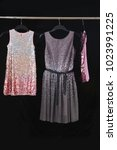 Small photo of sequins colorful sundress,shirts vest ack background
