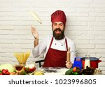 chef makes pizza. cook with...   Shutterstock . vector #1023996805