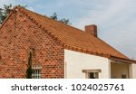 the roof of the house on sky... | Shutterstock . vector #1024025761