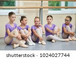 young ballerinas sitting on the ... | Shutterstock . vector #1024027744