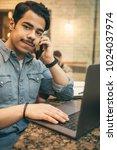 young arabian businessman... | Shutterstock . vector #1024037974