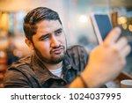 flirtatious selfie taking man... | Shutterstock . vector #1024037995