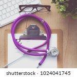 a medical stethoscope near a...   Shutterstock . vector #1024041745