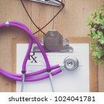 a medical stethoscope near a...   Shutterstock . vector #1024041781