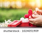 the woman is knitting red heart ... | Shutterstock . vector #1024051909
