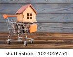 a wooden house on a shopping... | Shutterstock . vector #1024059754