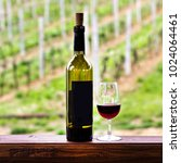 glasses and a bottle of wine.... | Shutterstock . vector #1024064461