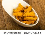 tumeric roots heap in the bowl... | Shutterstock . vector #1024073155