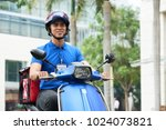 vietnamese delivery man riding... | Shutterstock . vector #1024073821
