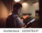 confused man using tablet... | Shutterstock . vector #1024078147