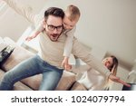 happy family  mother and father ... | Shutterstock . vector #1024079794