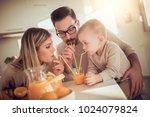 happy family drinking orange... | Shutterstock . vector #1024079824