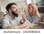 beautiful young couple eating... | Shutterstock . vector #1024080601