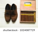 top view of brown shoes and... | Shutterstock . vector #1024087729