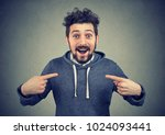 excited young man pointing at... | Shutterstock . vector #1024093441