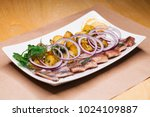 Stock photo restaurant dish baked potatoes with onion rings and herring 1024109887