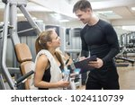 young fitness woman talking...   Shutterstock . vector #1024110739
