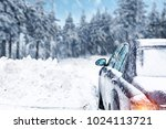a snow covered car with a ski... | Shutterstock . vector #1024113721