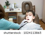 dentist is treating a boy's... | Shutterstock . vector #1024113865
