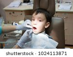 dentist is treating a boy's... | Shutterstock . vector #1024113871