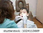 dentist is treating a boy's... | Shutterstock . vector #1024113889