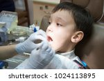 dentist is treating a boy's... | Shutterstock . vector #1024113895