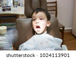 dentist is treating a boy's... | Shutterstock . vector #1024113901