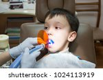 dentist is treating a boy's... | Shutterstock . vector #1024113919