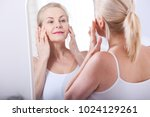 forty years old woman looking... | Shutterstock . vector #1024129261
